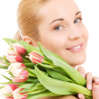 Happy womwith flowers — Stock Photo #11770427