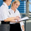 Stockfoto: Two happy businesswomen with paper chart