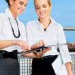 Two happy businesswomen with documents — 图库照片