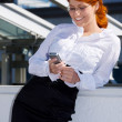 Happy businesswoman with phone — Stock Photo
