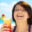 Happy woman with colorful cocktail — Stock Photo