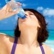 Stockfoto: Happy womwith bottle of water
