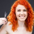 Redhead with scissors — Stok fotoğraf