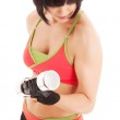 Muscular fitness instructor with dumbbells — Stock Photo #11772559