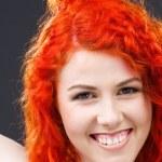 Redhead with scissors — Stock Photo