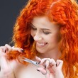 Royalty-Free Stock Photo: Redhead with scissors