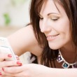 Woman with white phone — Stock Photo #11773214