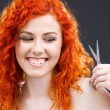 Redhead with scissors — Stock fotografie