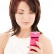 Happy woman with cell phone — Stock Photo #11773783