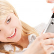 Happy woman using phone camera - Stock Photo