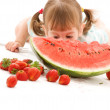 Little girl with strawberry and watermelon — Foto Stock