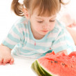 Little girl with strawberry and watermelon - Stock Photo