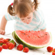 Stock Photo: Little girl with strawberry and watermelon