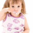 Little girl with yogurt — Stock Photo #11775019
