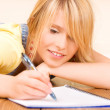 Teenage girl with notebook and pen — Stock Photo