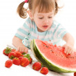 Little girl with strawberry and watermelon — Stock Photo #11775343