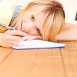 Foto Stock: Teenage girl with notebook and pen