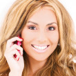 Happy woman with cell phone — Stockfoto