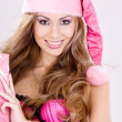Cheerful santa helper girl with gift box — Stock Photo #11775407