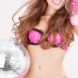 Santa helper in pink lingerie with disco ball — Stock Photo #11775462
