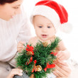 Baby and mother with christmas gifts — Stock Photo #11775618