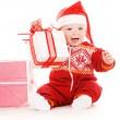 Stock Photo: Santa helper baby with christmas gifts