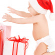 Santa helper baby with christmas gifts — Stock Photo #11775757