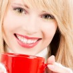 Happy teenage girl with red mug — Stock Photo #11775870