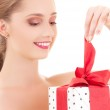 Happy girl with gift box — Stock Photo #11776072
