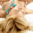 Dreaming blond in bed — Stock Photo