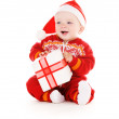 Santa helper baby with christmas gift — Stock Photo #11776241