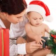 Baby and mother with christmas gifts — Stock Photo