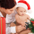 Baby and mother with christmas gifts — Stock Photo #11776243
