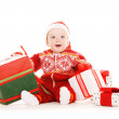 Santa helper baby with christmas gifts — Stock Photo #11776326