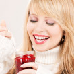 Happy teenage girl with raspberry jam — Stock Photo #11776368