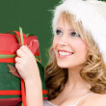 Happy santa helper with gift box — Stock Photo #11776406