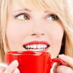 Happy teenage girl with red mug — Stock Photo #11776414