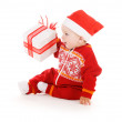 Santa helper baby with christmas gift — Stock Photo #11776478