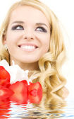 Happy woman with lily flowers — Stock Photo