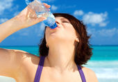Happy woman with bottle of water — Stock Photo