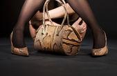 Snakeskin shoes and handbag — Stock Photo