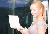 Happy businesswoman with laptop computer — Stock Photo