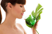 Woman with green leaf and glass of water — Stock Photo