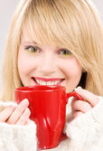 Happy teenage girl with red mug — Stock Photo