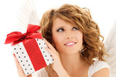 Angel with gift — Stockfoto