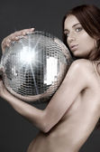 Beautiful naked woman with disco ball — Stock Photo