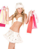 Cheerful santa helper with shopping bags — Stock Photo