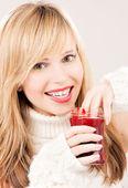 Happy teenage girl with raspberry jam — Stock Photo