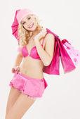 Pomocnik santa z różowym torby na zakupy — Zdjęcie stockowe