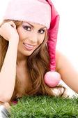 Ayudante de santa feliz en sombrero rosa — Foto de Stock